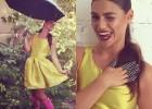תמונה של עבודות מורים - בשמלה צהובה ומגפיים ורודים